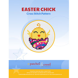 This PDF booklet has a newly hatched, cross stitched chick on the cover. The egg the chick is hatching from is brightly dyed in Easter colours.