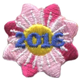 A red and pink flower with eight petals and a yellow center. The date '2016' rests in the middle of this one inch flower.