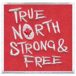 This square patch is red with a white border. The words 'True North Strong & Free' are embroidered with white thread.