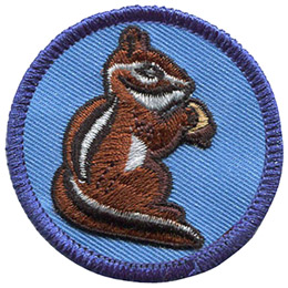 This circular patch displays the side view of a chipmunk, a small stripped rodent, holding an acorn.
