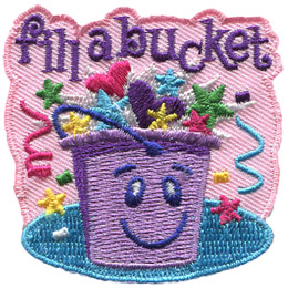 A smiling purple bucket is filled to overflowing with hearts, stars, and confetti. The words 'Fill A Bucket' is embroidered at the top of the patch.