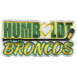 The word 'Humboldt' is embroidered in green block letters with a yellow trim. Underneath the is the word 'Broncos' embroidered in yellow letters with green trim. The 'o' in 'Humboldt' is a heart. A hockey stick rests on its side in the middle on the patch, seperating the two words.