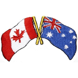 The Canada Flag on a pole is crossed over the pole of an Australian Flag in the symbol of friendship.
