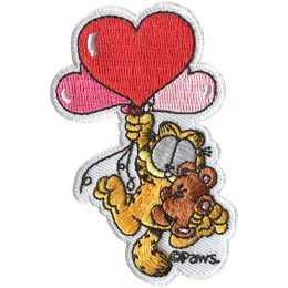 Garfield, the orange and black-stripped, overweight house-cat, dangles from three heart shapped balloons he is holding with one paw and his teddybear, Pooky, with the other. The PAWS trademark sits at the bottom right of the patch.