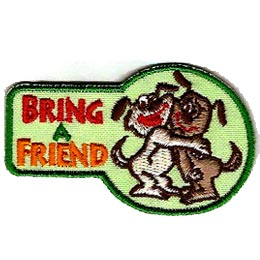 A cartoon, tan coloured dog stands on its hind legs and holds a brown coloured dog in the tight embrace of a friendly hug. The words ''Bring A Friend'' are embroidered to the left of the puppies.