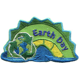The middle hump of a sea serpent. The words 'Earth Day' are embroidered along the middle of the hump. A globe of Earth within the three recycle arrows rests on the left most section of the hump.