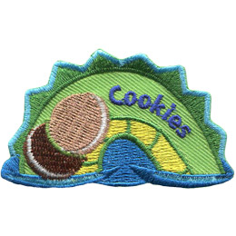 The middle hump of a sea serpent. The word 'Cookies' is embroidered along the middle of the hump. Two cream-filled cookies rest on the left most section of the hump.